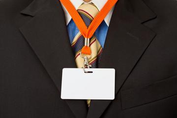 Geschäftsmann mit Ausweis, Visitenkarte am Schlüsselband
