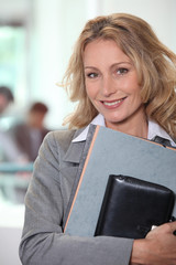 Businesswoman carrying files and an agenda