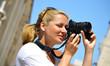 Woman taking photos on the street
