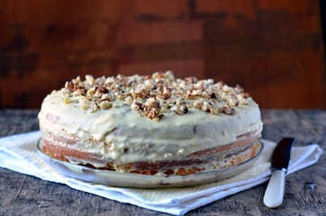 Biscuit cake with custard cream and nuts