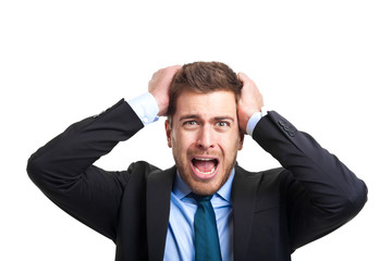 Angry businessman with hands in his hair