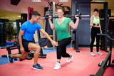 Individual training. Plus sized woman working out with personal