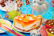 cake with three candles on birthday party table for child