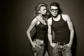 Sexy man and woman doing a fashion photo shoot