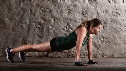 Woman Doing Push-ups Alone