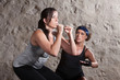 Lady and Trainer Sweating During Boot Camp Style Workout