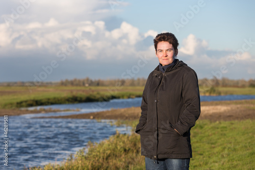Woman in a beautiful wetland landscape in the Netherlands