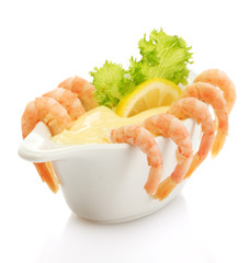 Boiled shrimp with sauce, lettuce leaf and lemon, isolated