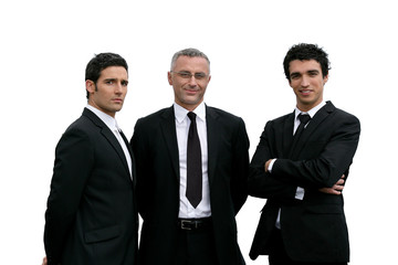 Three confident businessmen on white background