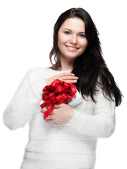 Pretty young woman holding a gift to her breast