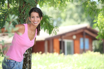 Brunette woman in front of chalet