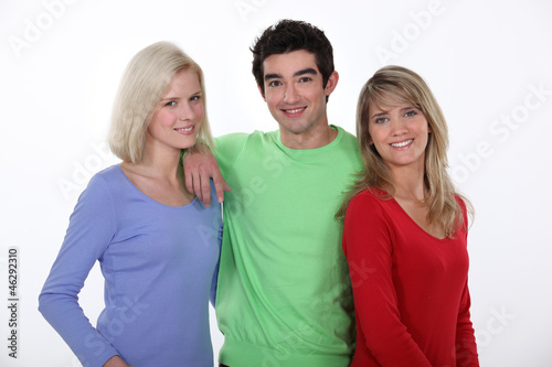 Man in the middle of two women