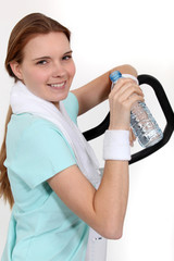 Woman hydrating herself after workout