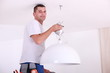 Man installing a ceiling light