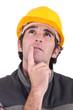 Tradesman deep in thought