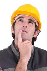 Tradesman deep in thought
