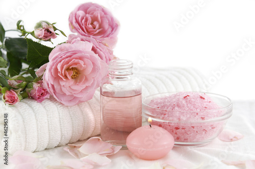 Spa setting with branch roses on towel ,salt in bowl,