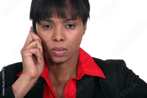 Stern businesswoman making call