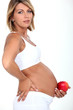 Pregnant woman with an apple