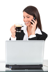 Woman drinking an expresso at her desk