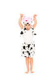 Little girl dressed in cow