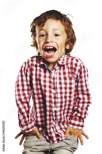 laughing child with hands in pockets