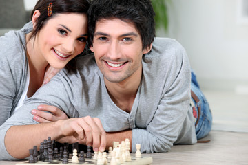 Attractive couple playing chess