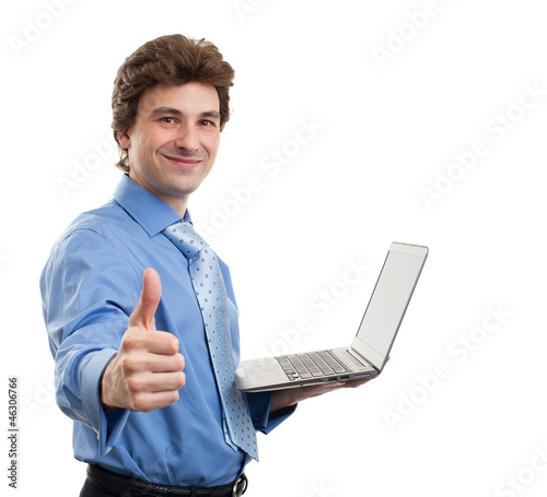 businessman with laptop computer showing his thumbs up