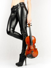 Beautiful legs of violinist