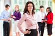 Business - Team oder Geschäftsleute im Büro