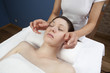 physical therapist practicing a facial massage