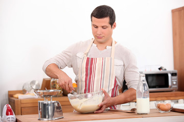 Man stirring mixture in bowl