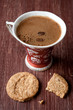 Cup of coffee and cookies on a vintage board