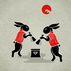 Japanese moon rabbits making mochi (rice cakes)