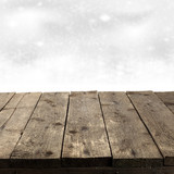 rustic wood plank with snowflakes at the background