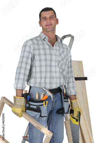 Carpenter standing by a ladder