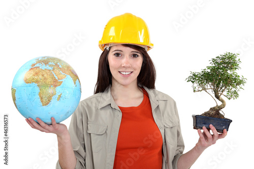 Girl holding a globe and a bonsai