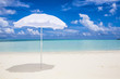 white sunshade  at the beach