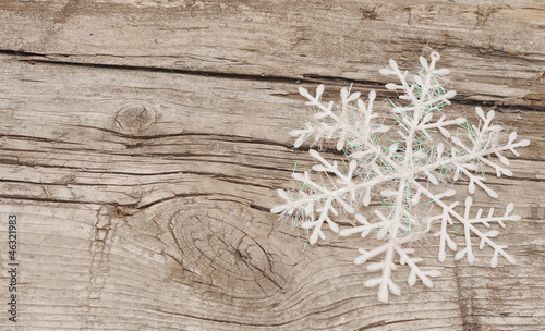 Christmas decorations (snowflake) on wooden background