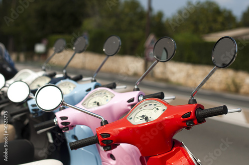 A line of mopeds/scooters