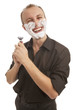 smiling man shaving