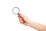Woman's hand holding a magnifying glass