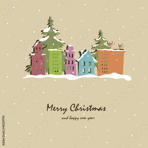 Christmas card with snow-covered buildings and trees