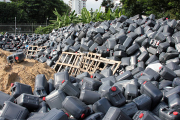 Plastic jerrycans at landfill
