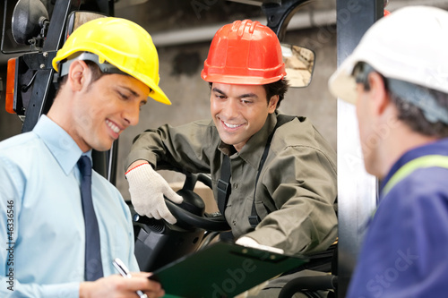 Workers And Supervisors At Warehouse