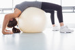 Woman stretching using exercise ball