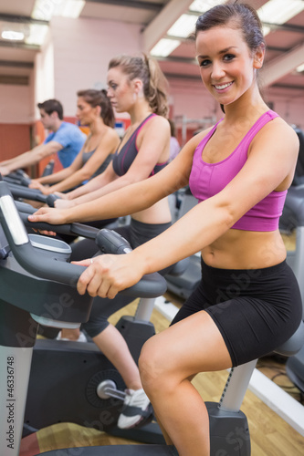Woman happy on exercise bicycle