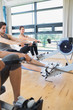 Woman looking up from rowing machine workout