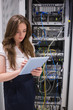 Woman checking servers using tablet pc