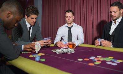 Men playing high stakes game